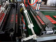 Bottom bag machine with auto conveyor